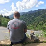 Photo of Jeff Chandler and his dog overlooking the smoky mountains at Newfound Gap